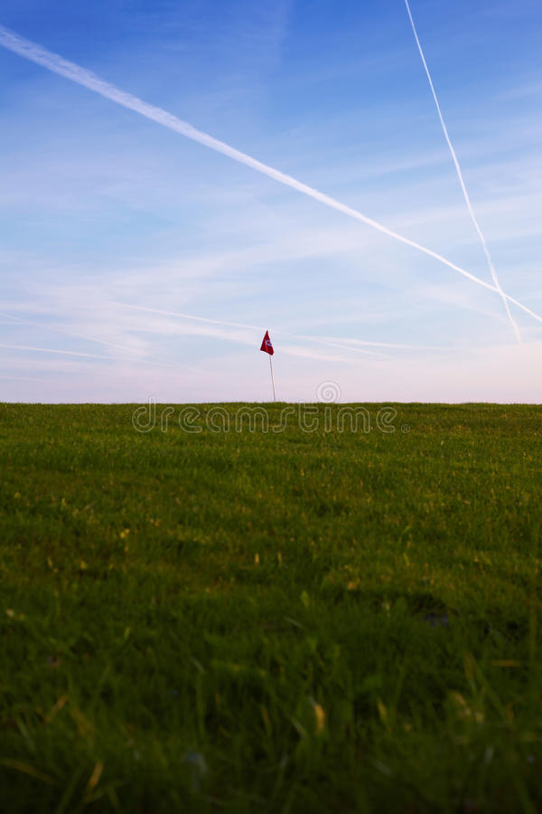 Flag On A Golf Course Royalty Free Stock Image