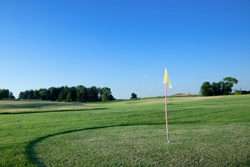 Flag On Golf Course. Stock Photo