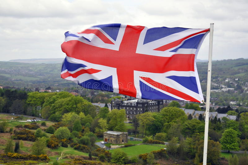 Flag of Great Britain on British landscape royalty free stock images