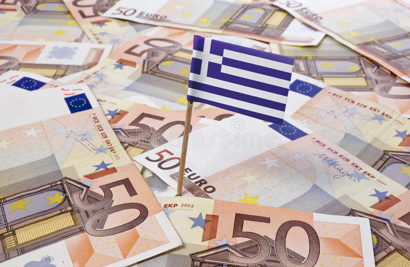Flag of Greece sticking in 50 Euro banknotes.(series). Flag of Greece sticking in european banknotes.(series royalty free stock images