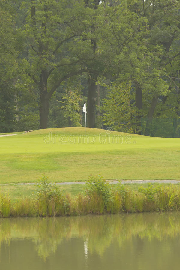 Download Flag And The Green Golf Field Stock Photo - Image: 26289872