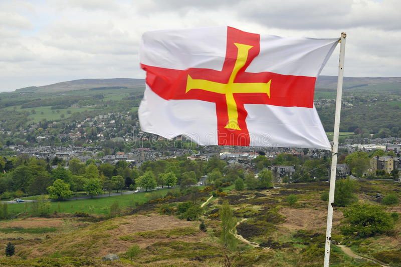 Download Flag Of Guernsey Over British Landscape Stock Photo - Image: 14369504