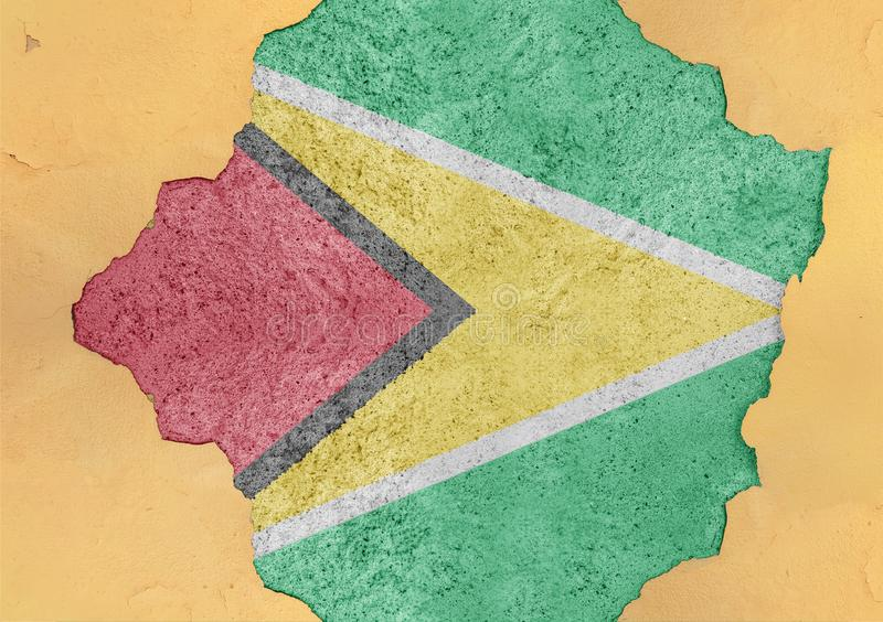 Flag of Guyana in big broken material concrete cracked hole facade. Structure royalty free stock photos
