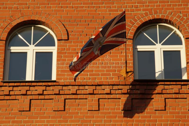 The flag is in harmony with the elements of the facade. royalty free stock photography