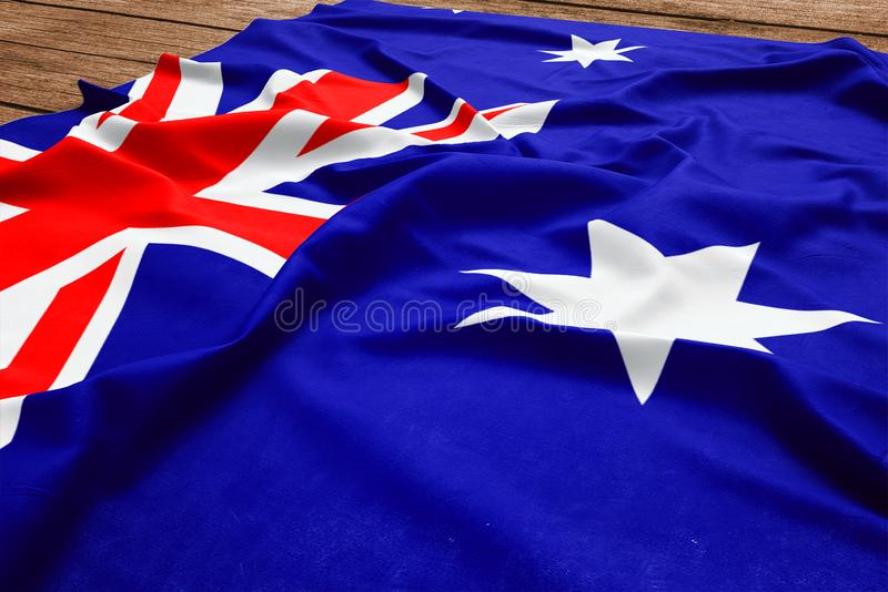 Flag of Heard Island And Mcdonald Islands on a wooden desk background. Silk flag top view royalty free stock image