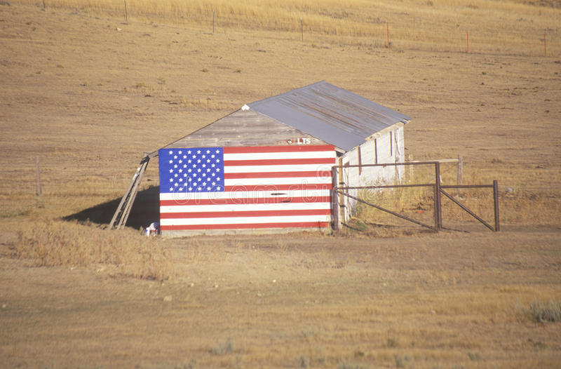 Download Flag Hung on an Old Barn stock image. Image of field - 26890897