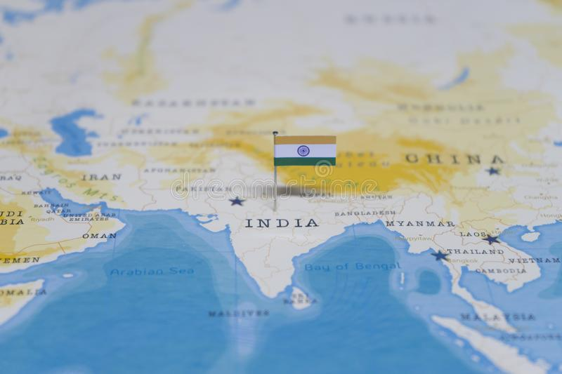 The Flag of india in the world map royalty free stock photo