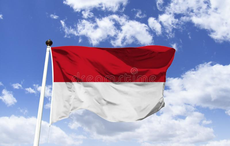 Flag of Indonesia, called `Sang Sake Merah Putih`. Was hoisted on the country`s independence day, official colors: red representing courage and white royalty free stock photography
