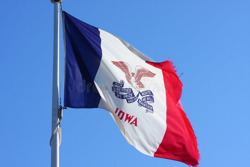 Flag of Iowa. Iowa flag with wind and motto royalty free stock image