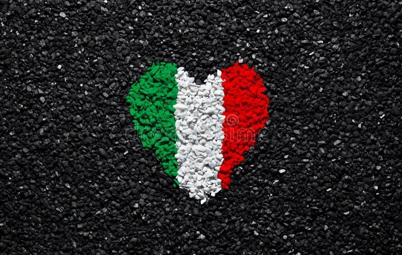 Flag of Ireland, Irish flag, heart on the black background, stones, gravel and shingle, textured wallpaper royalty free stock photography