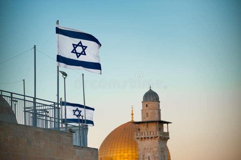 Flag of Israel. Dome of the Rock in the old city of Jerusalem, Israel. Sunset and blue sky stock photography