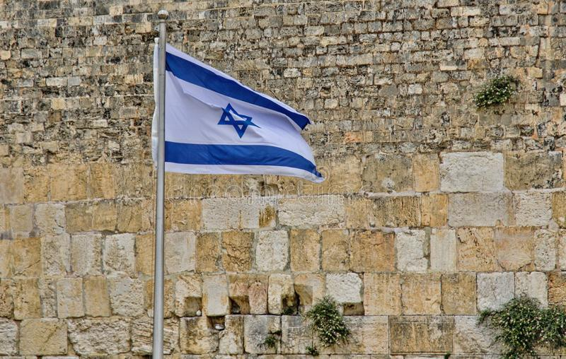 Flag of Israel at the Western Wall. royalty free stock image