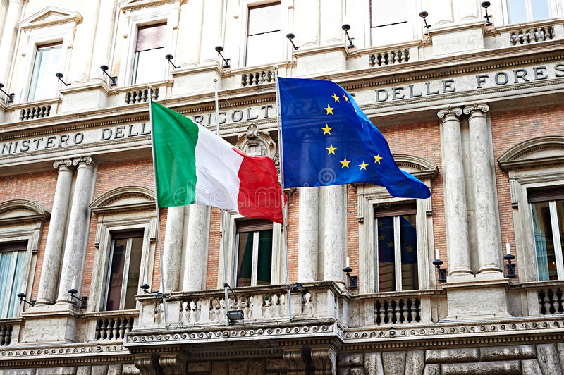 Flag of Italy and United Europe on government in Rome. Flag of Italy and the United Europe on government buildings in Rome royalty free stock photos