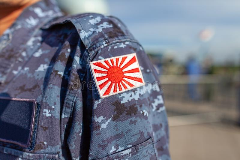 Flag of Japan patch on a soldier uniform. Rising Sun Flag of Japan patch on a soldier uniform royalty free stock image