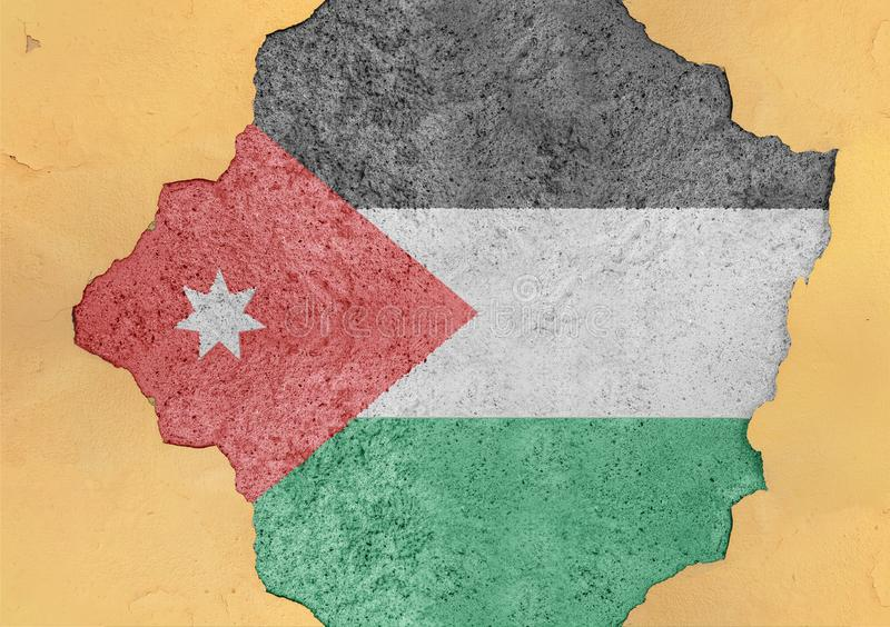 Flag of Jordan in big broken material concrete cracked hole facade. Structure stock image