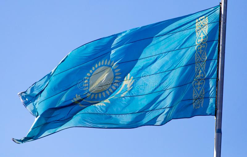 Flag of Kazakhstan against the blue sky royalty free stock photography