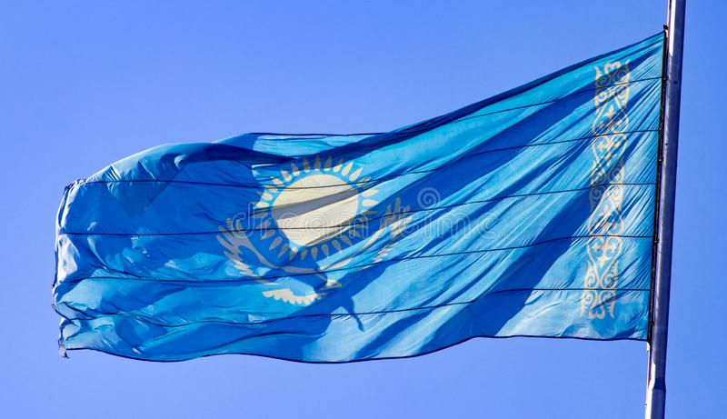 Flag of Kazakhstan against the blue sky stock images