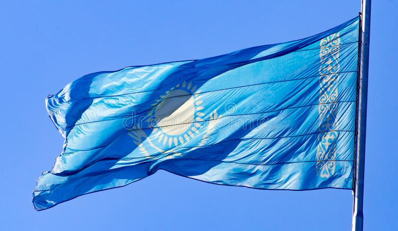 Flag of Kazakhstan against the blue sky royalty free stock photos