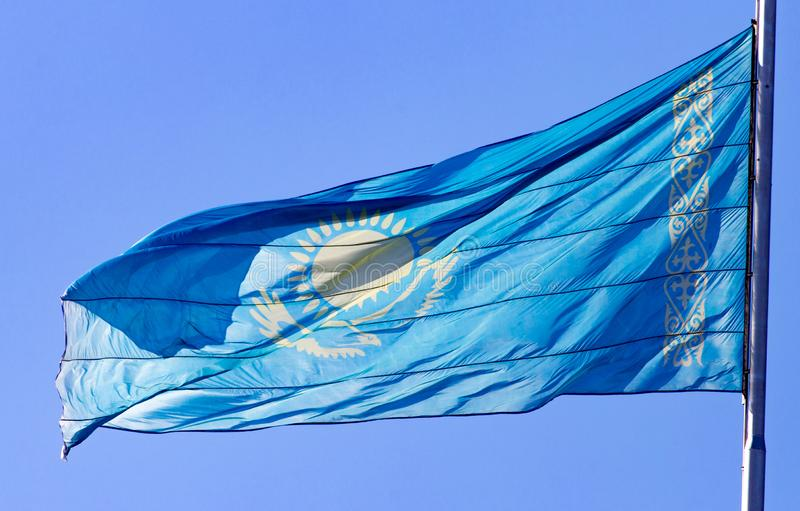 Flag of Kazakhstan against the blue sky stock image