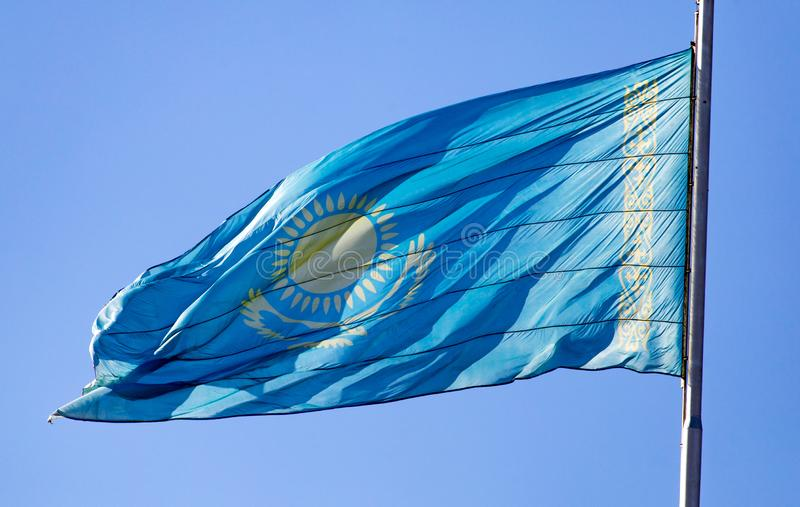 Flag of Kazakhstan against the blue sky stock photography