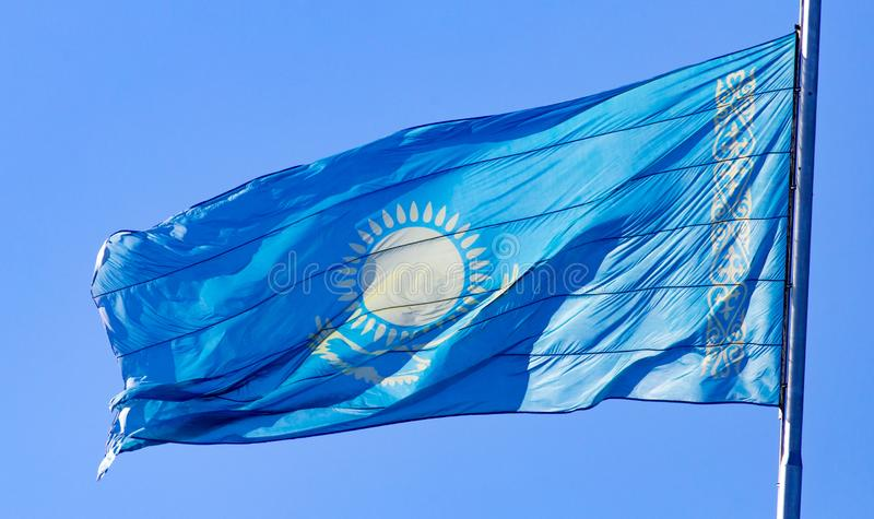 Flag of Kazakhstan against the blue sky stock photo