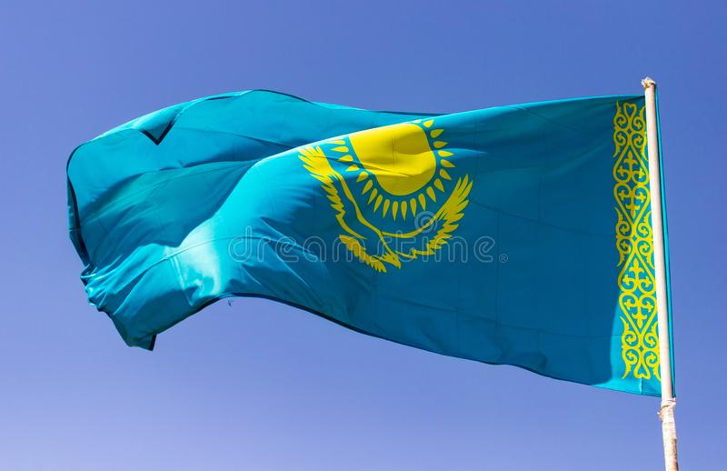 Flag of Kazakhstan against the blue sky royalty free stock image