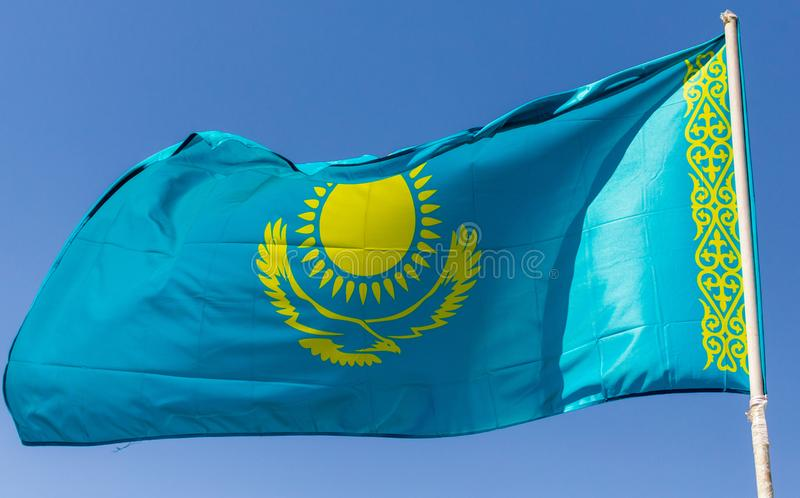 Flag of Kazakhstan against the blue sky royalty free stock image