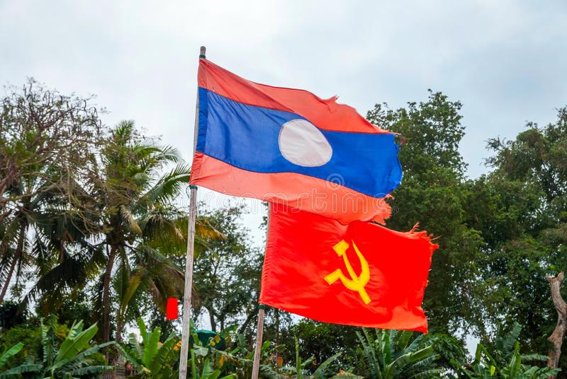 Flag of Laos and communism. Laotian and communist flag waving in the wind, national, country, government, symbol, banner, laos, communism, comunistic, patriotic stock image
