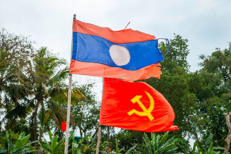 Flag of Laos and communism. Laotian and communist flag waving in the wind, national, country, government, symbol, banner, laos, communism, comunistic, patriotic royalty free stock photography