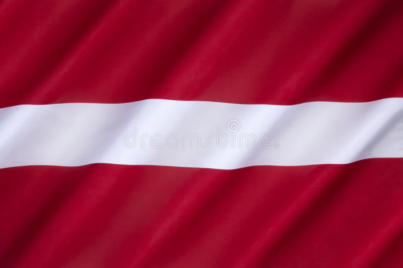 Flag of Latvia. Used by independent Latvia from 1918 until the country was occupied by the Soviet Union in 1940. Its use was suppressed during Soviet rule stock images