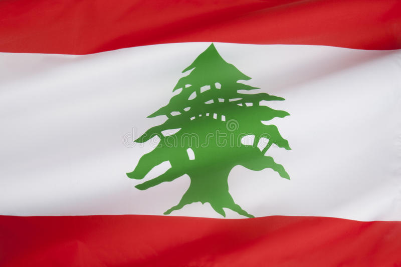 Flag of Lebanon. The flag of Lebanon was designed to be a neutral flag, not allied to any one of Lebanon's religious groups. The red stripes symbolize the blood royalty free stock photos