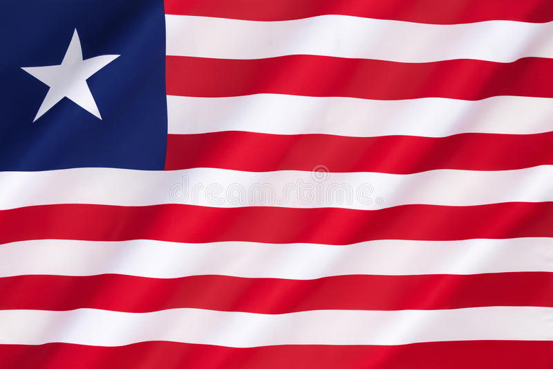 Flag of Liberia. Adopted on Friday 26th April 1847. The flag is seen on many ships around the world as Liberia offers registration under its flag. Shipping royalty free stock image