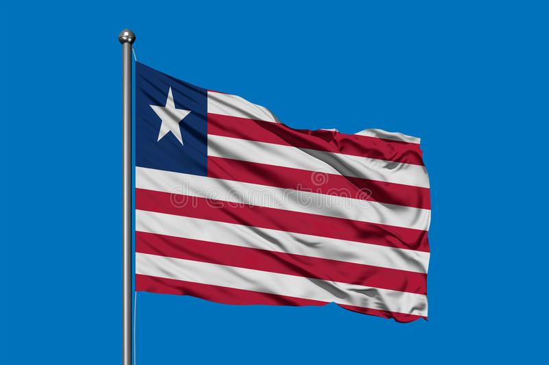 Flag of Liberia waving in the wind against deep blue sky. Liberian flag royalty free stock photo