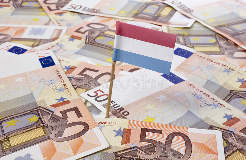 Flag of Luxembourg sticking in 50 Euro banknotes. (series). Flag of Luxembourg sticking in european banknotes. (series stock photos