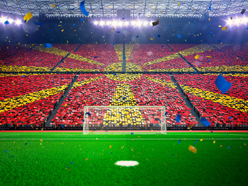 Flag Macedonia of fans. Evening stadium arena Blue stock photography