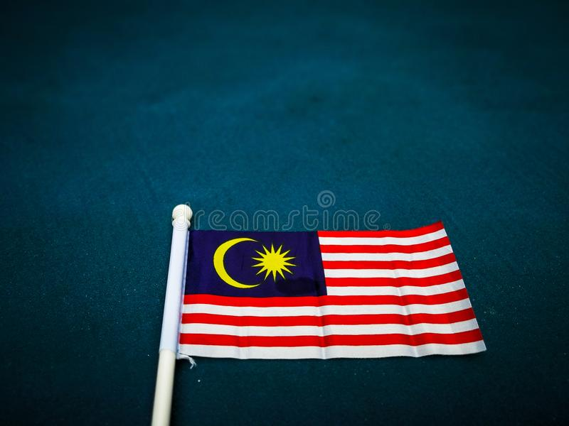 The flag of Malaysia on a dark background. stock image