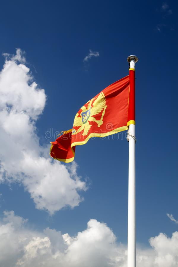 Flag of Montenegro against blue sky royalty free stock image