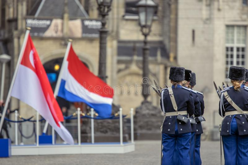 Flag Of The Netherlands And Singapore When The President Of Singapore Visited At Amsterdam The Netherlands 21-11-2018.  royalty free stock image