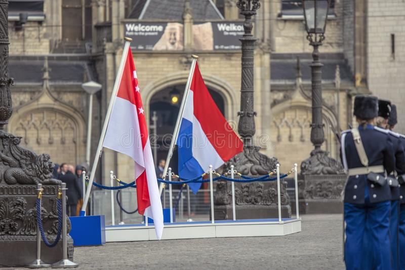 Flag Of The Netherlands And Singapore When The President Of Singapore Visited At Amsterdam The Netherlands 21-11-2018.  royalty free stock images