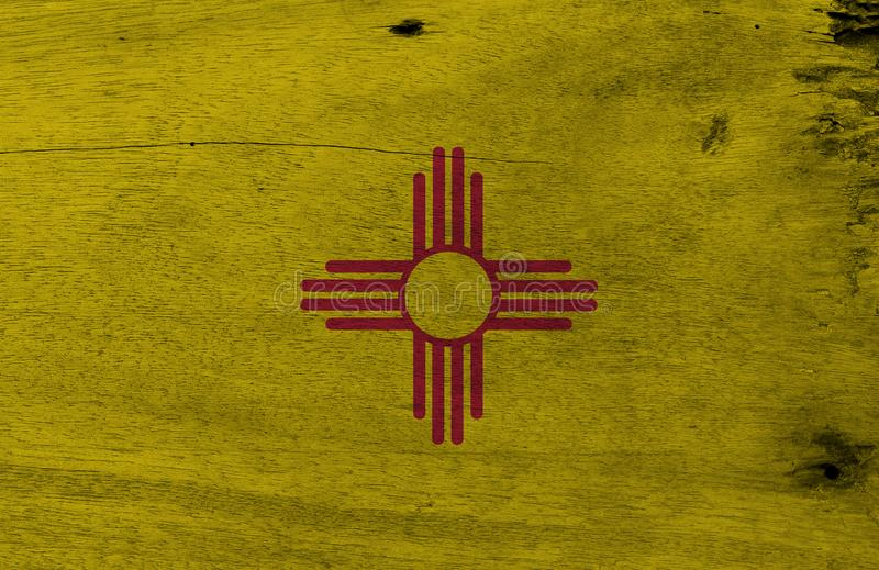 Flag of New Mexico on wooden plate background. Grunge New Mexico flag texture, The states of America. royalty free stock photo