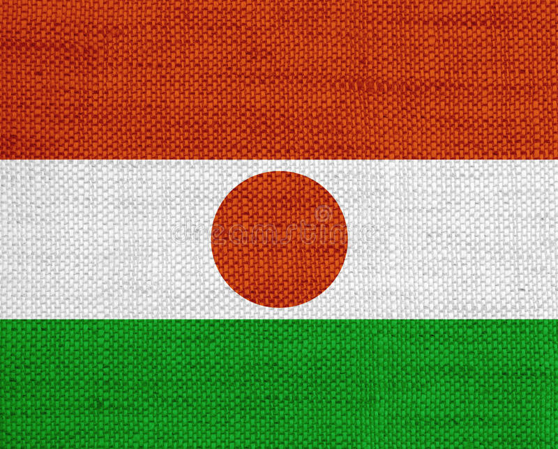 Flag of Niger on old linen. Colorful and crisp image of flag of Niger on old linen stock images