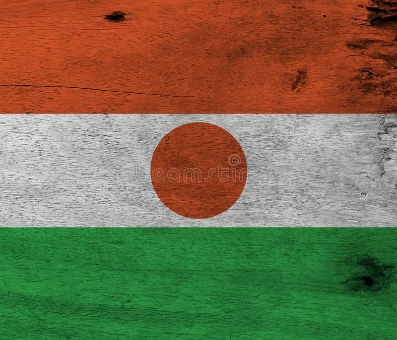 Flag of Niger on wooden plate background. Grunge Nigerien flag texture. Flag of Niger on wooden plate background. Grunge Nigerien flag texture, orange white and stock photography