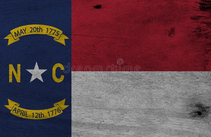 Flag of North Carolina on wooden plate background. Grunge North Carolina flag texture. Flag of North Carolina on wooden plate background. Grunge North Carolina stock photos