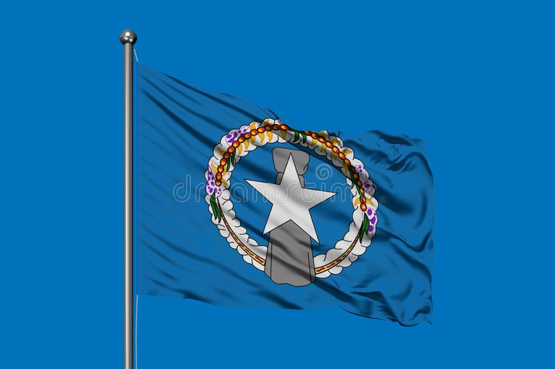 Flag of Northern Mariana Islands waving in the wind against deep blue sky royalty free stock images