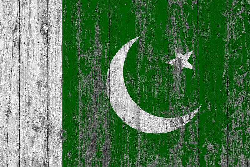 Flag of Pakistan painted on worn out wooden texture background royalty free stock photo