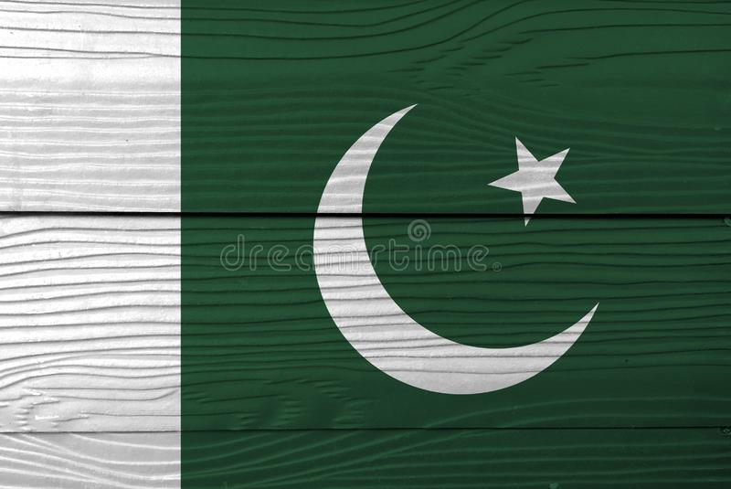 Flag of Pakistan on wooden wall background. Grunge Pakistani flag texture. royalty free stock images