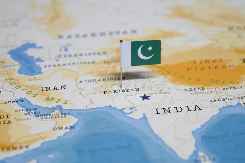 The Flag of pakistan in the world map.  stock photo
