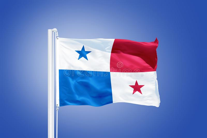 Flag of Panama flying against a blue sky.  stock photography