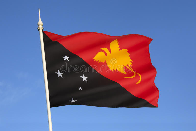 Flag of Papua New Guinea - South East Asia. The flag of Papua New Guinea was adopted on July 1, 1971. It depicts the Southern Cross and a Raggiana bird of stock images