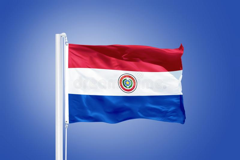 Flag of Paraguay flying against a blue sky.  royalty free stock images